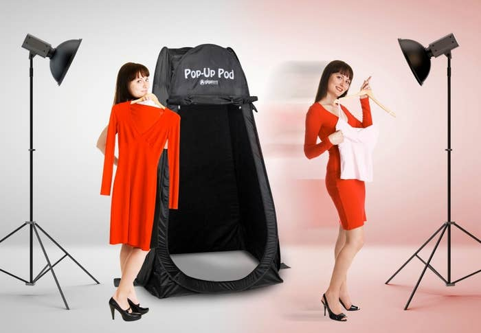 Model using the pop-up tent to change their outfit