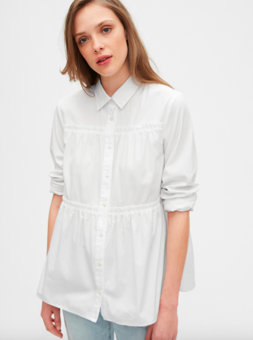 A model wearing the tiered button-up in white.
