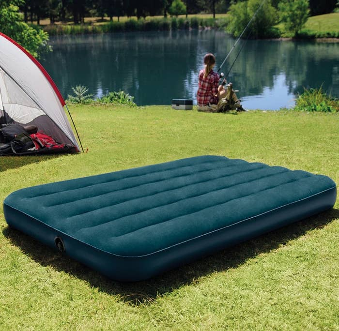 The air mattress on grass outside