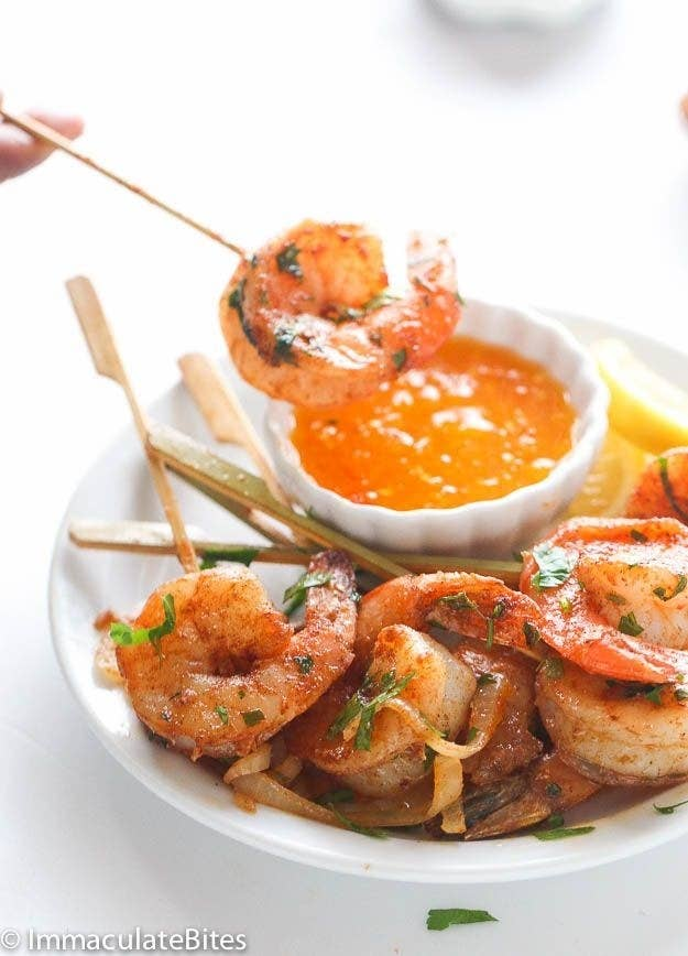 Images of Jamaican jerk shrimp on skewers with a fruity pepper dipping sauce