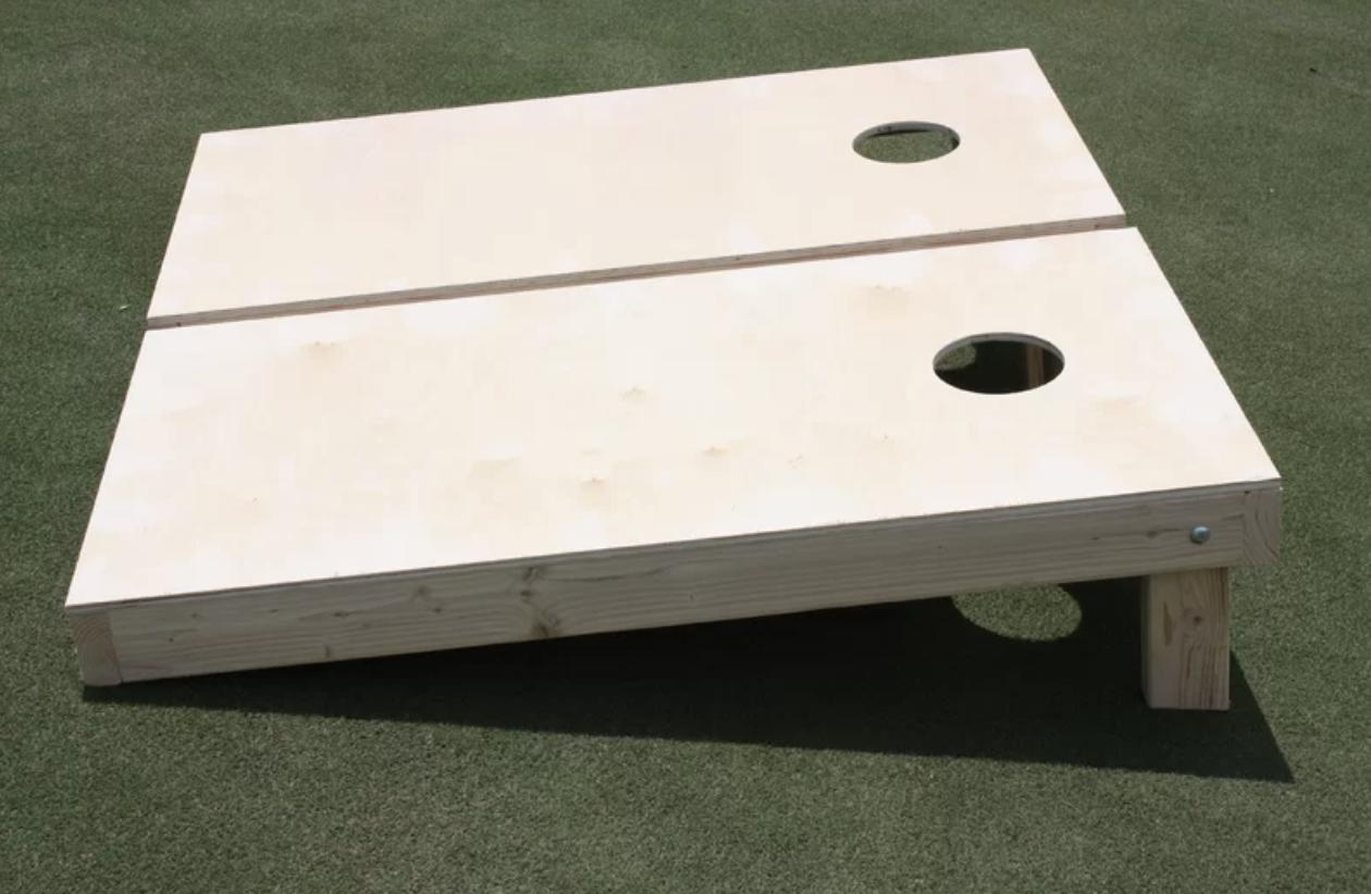 Two wooden cornhole boards