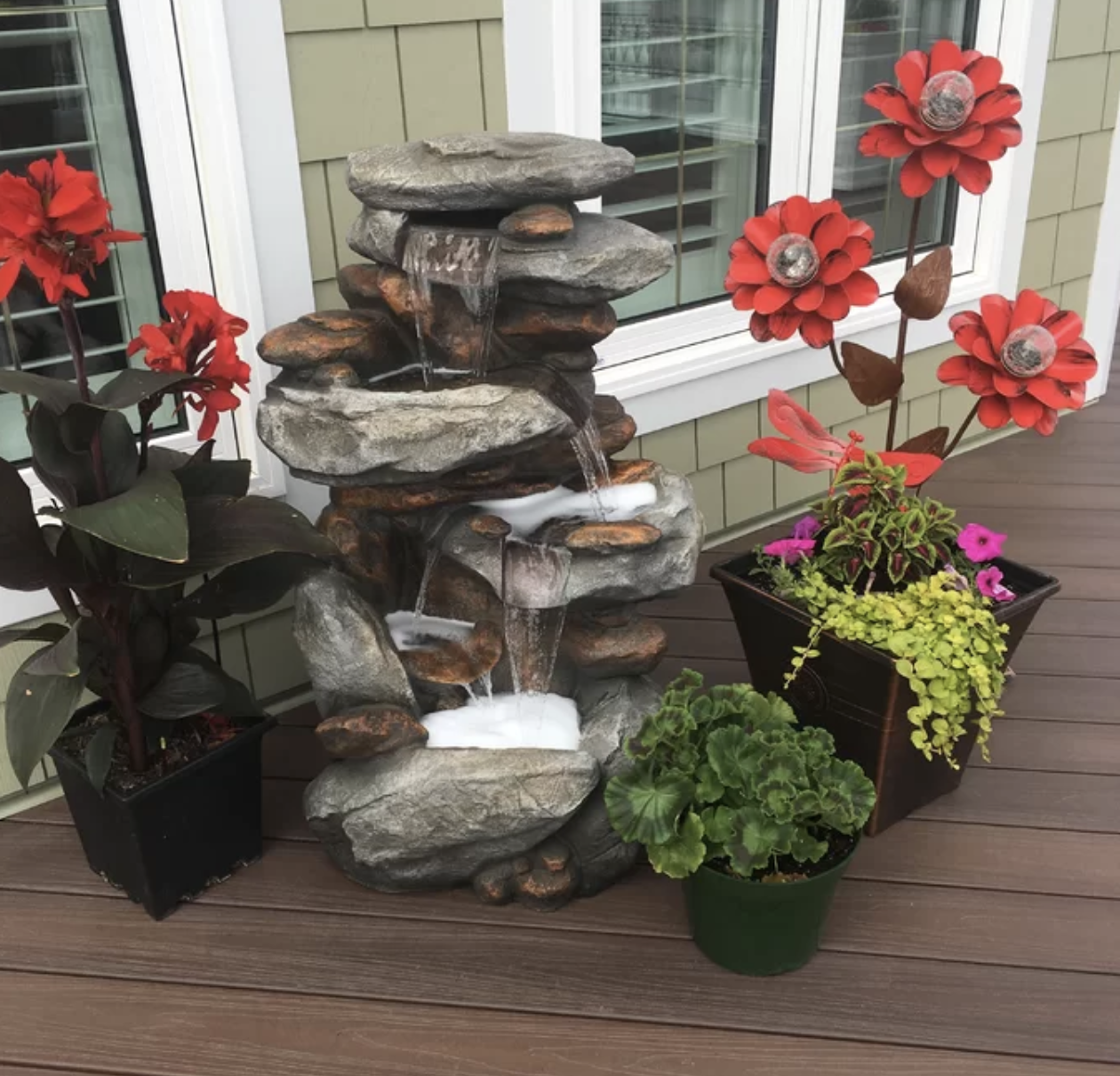 Reviewer's photo of the fountain on their deck