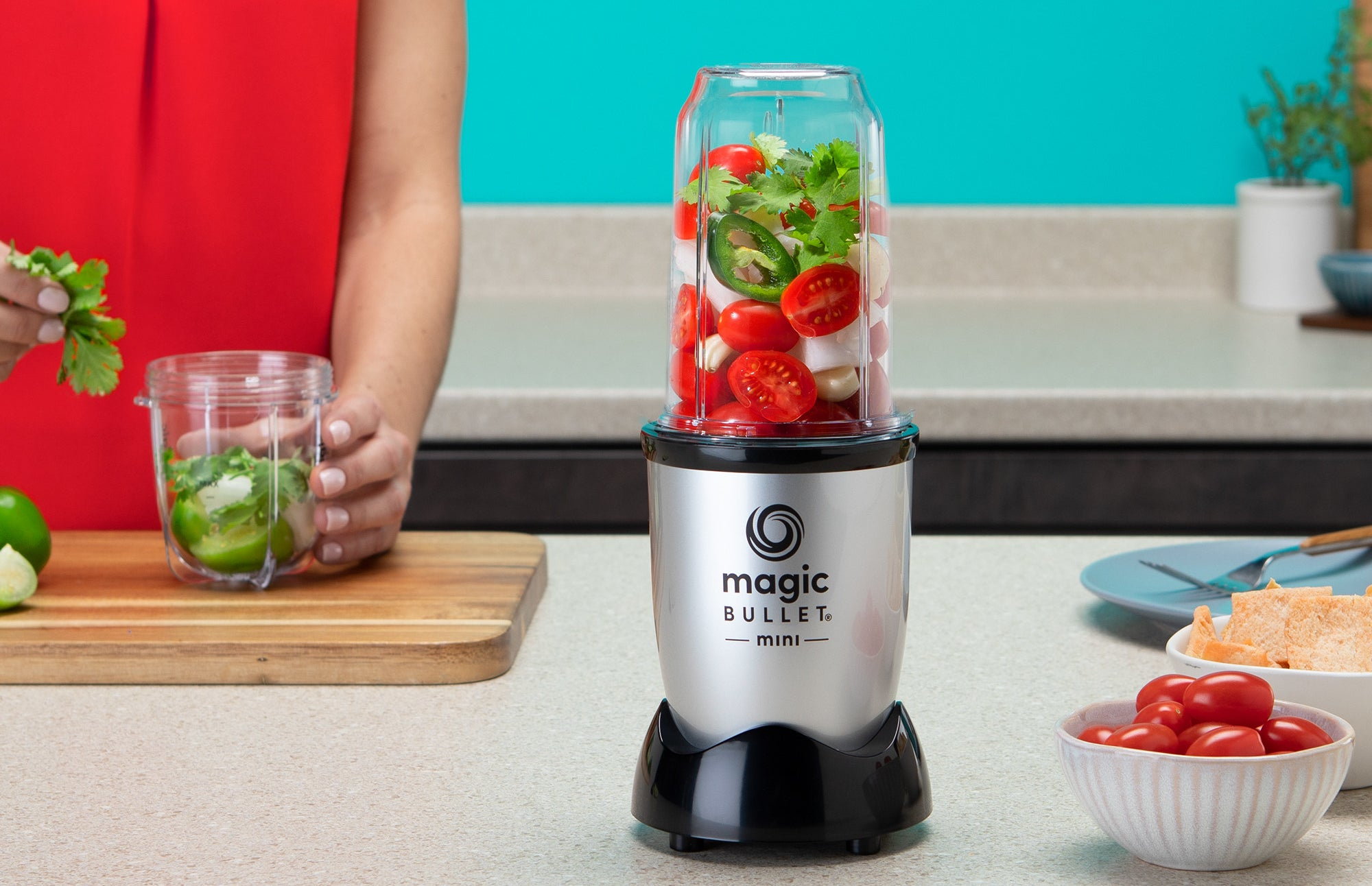 a silver and black magic bullet blending machine