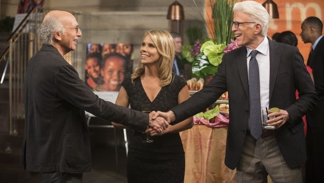 Ted Danson shaking hands with Larry David, alongside Cheryl in Curb Your Enthusiasm