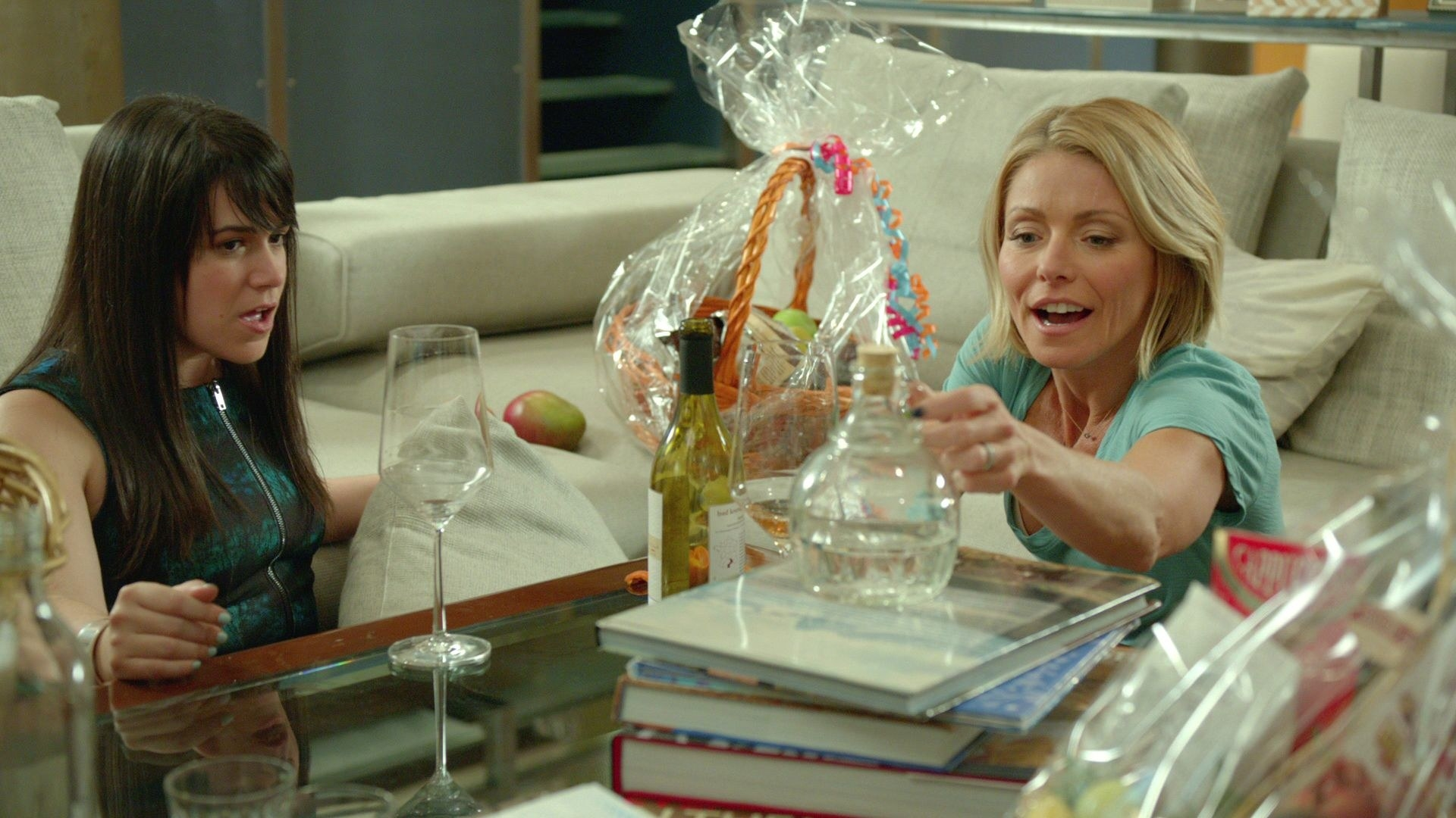 Kelly Ripa sitting with Abbi in Broad City