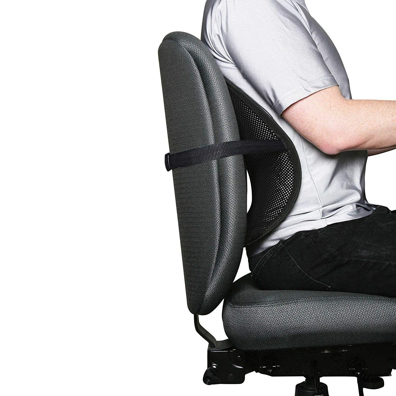 A person sitting on a chair with the support cushion attached.