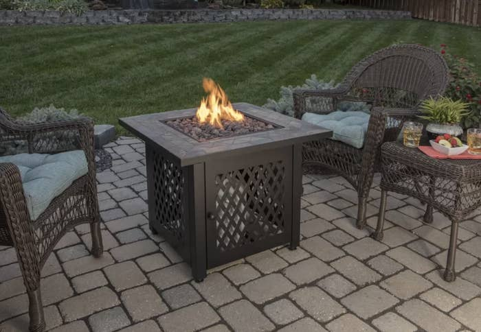 The fire pit in a yard
