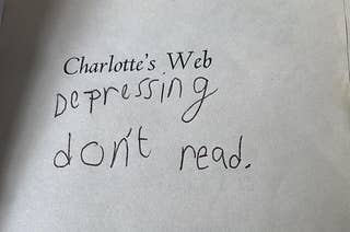 Title page of Charlotte's Wed with a kid's handwriting underneath it saying