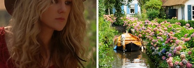 A witch from american horror story and a cozy cabin on a quiet river surrounded by trees and blooming flowers