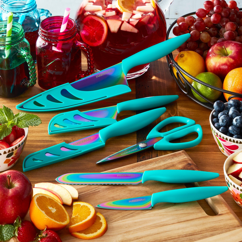 rainbow teal titanium knife set on cutting board