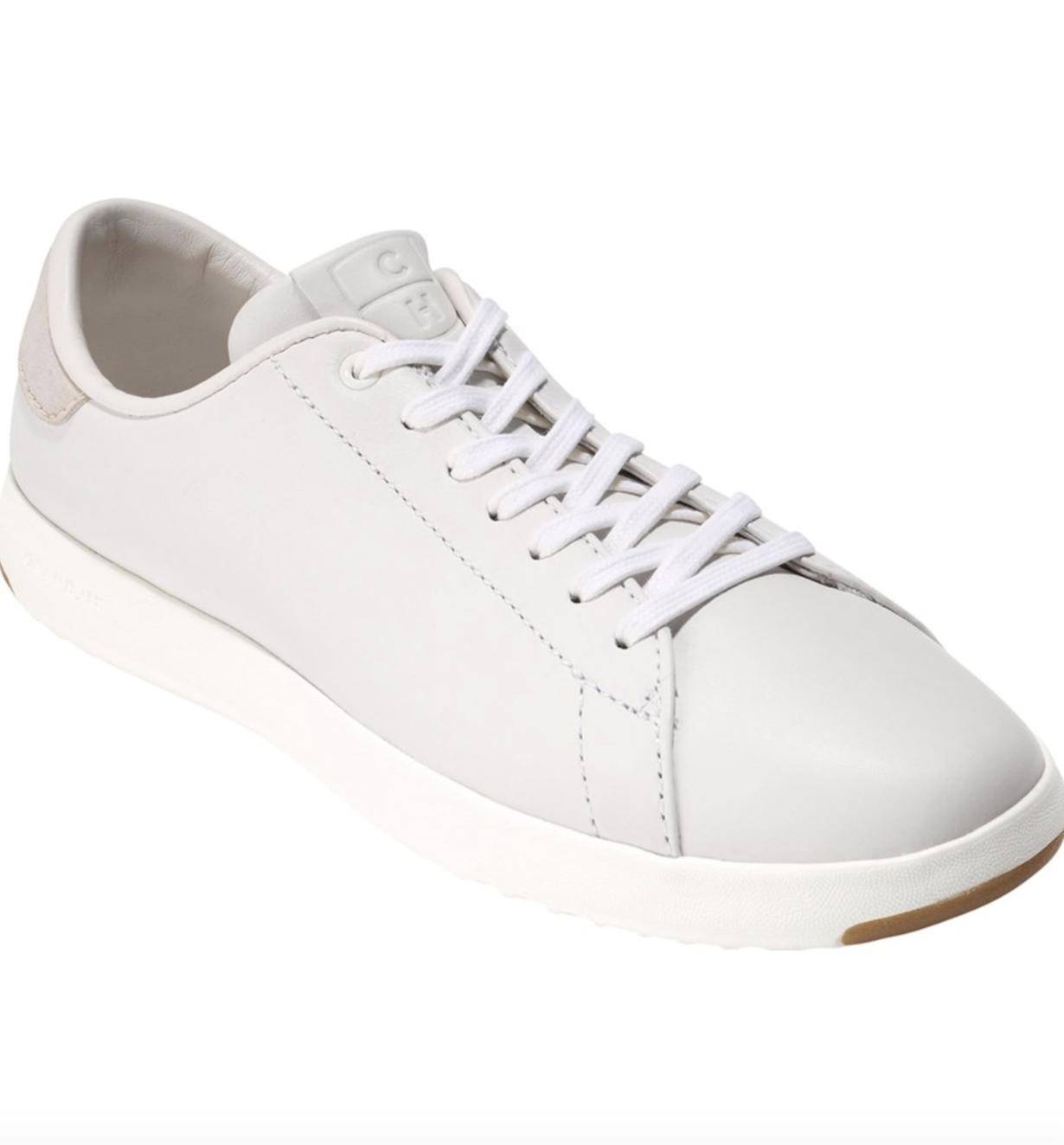 The leather tennis shoes in off-white with white sole and white laces