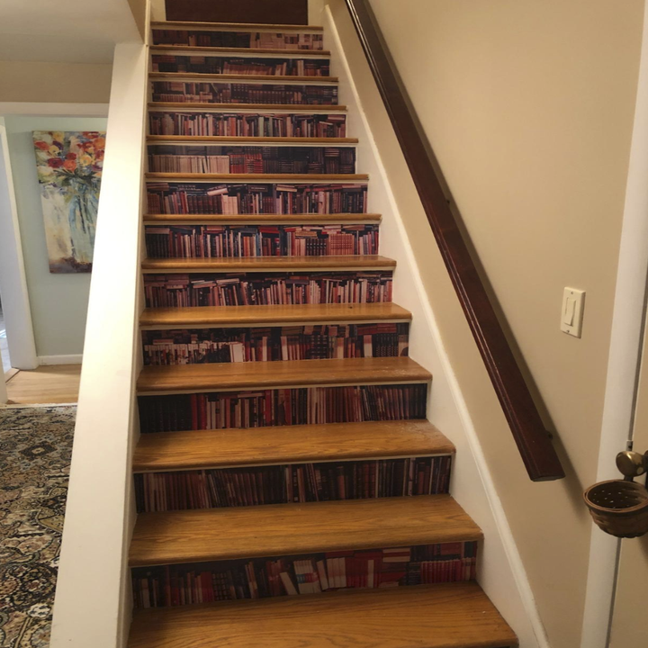 wallpaper on the vertical portion of each step in a staircase. When standing in front of the staircase, all the steps look like books on a bookcase
