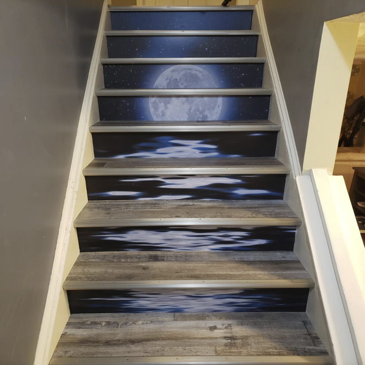 a reviewer's staircase with another version of the stickers that creates one big moonlight over ocean water scene