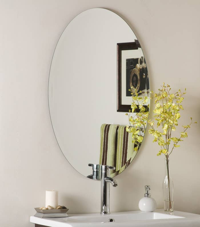 The large oval mirror