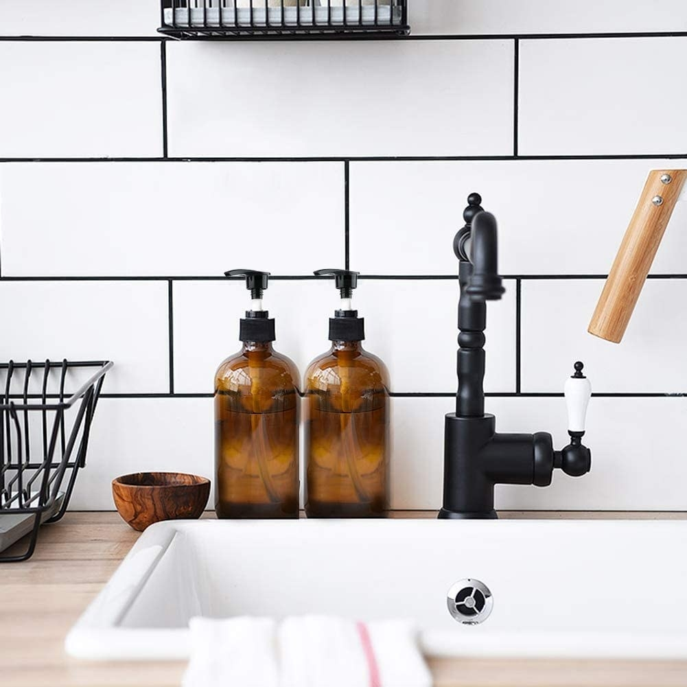 Two apothecary bottles behind a sink