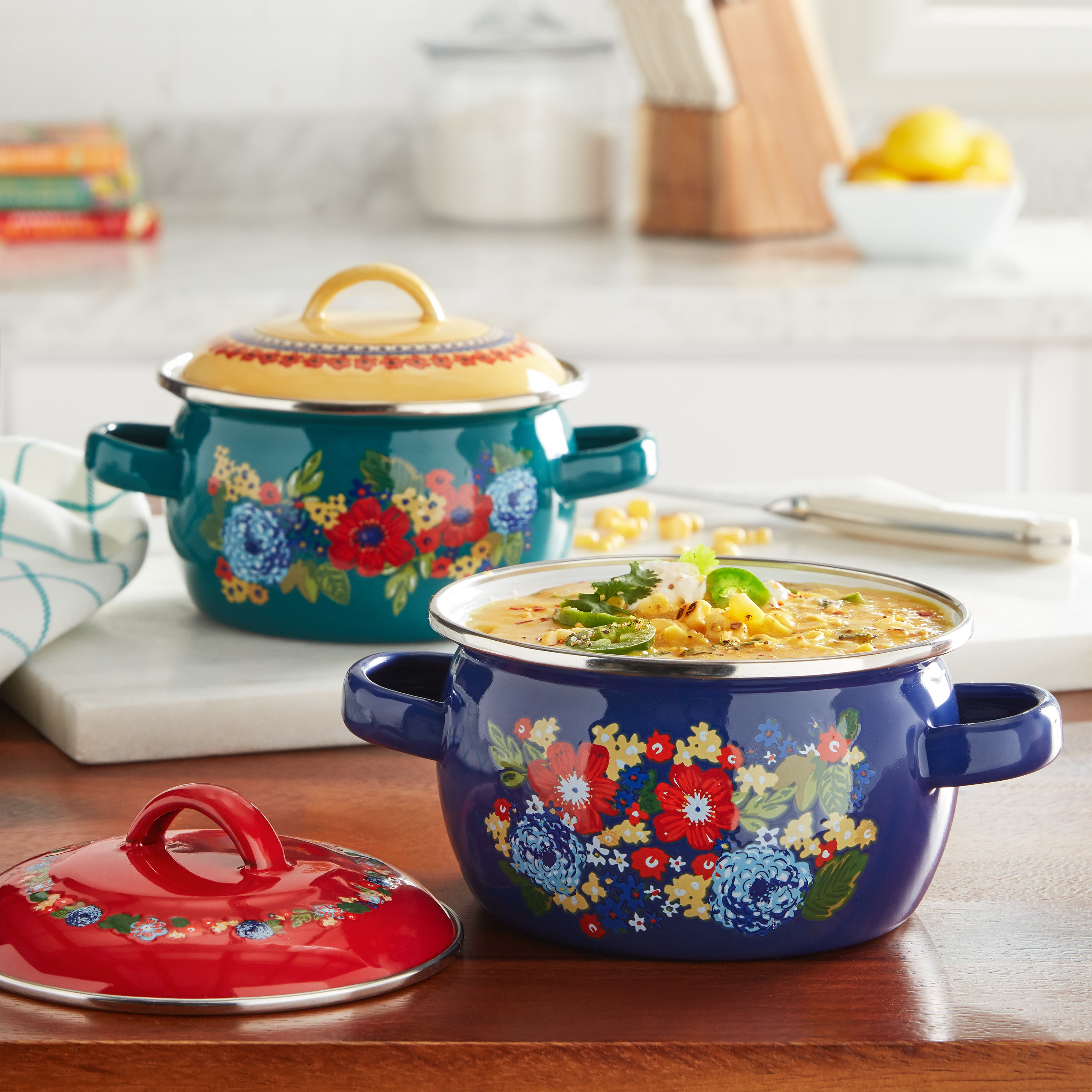 Two colorful mini Dutch ovens on a counter