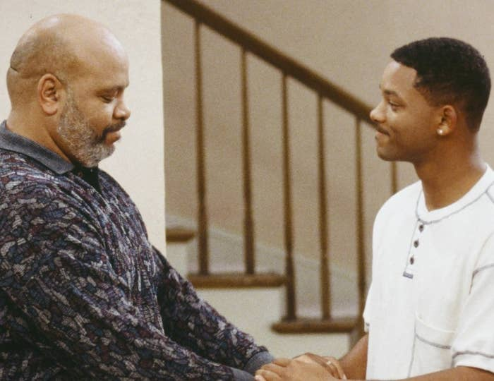 James Avery and Will Smith embrace hands, showing emotion and care for one another