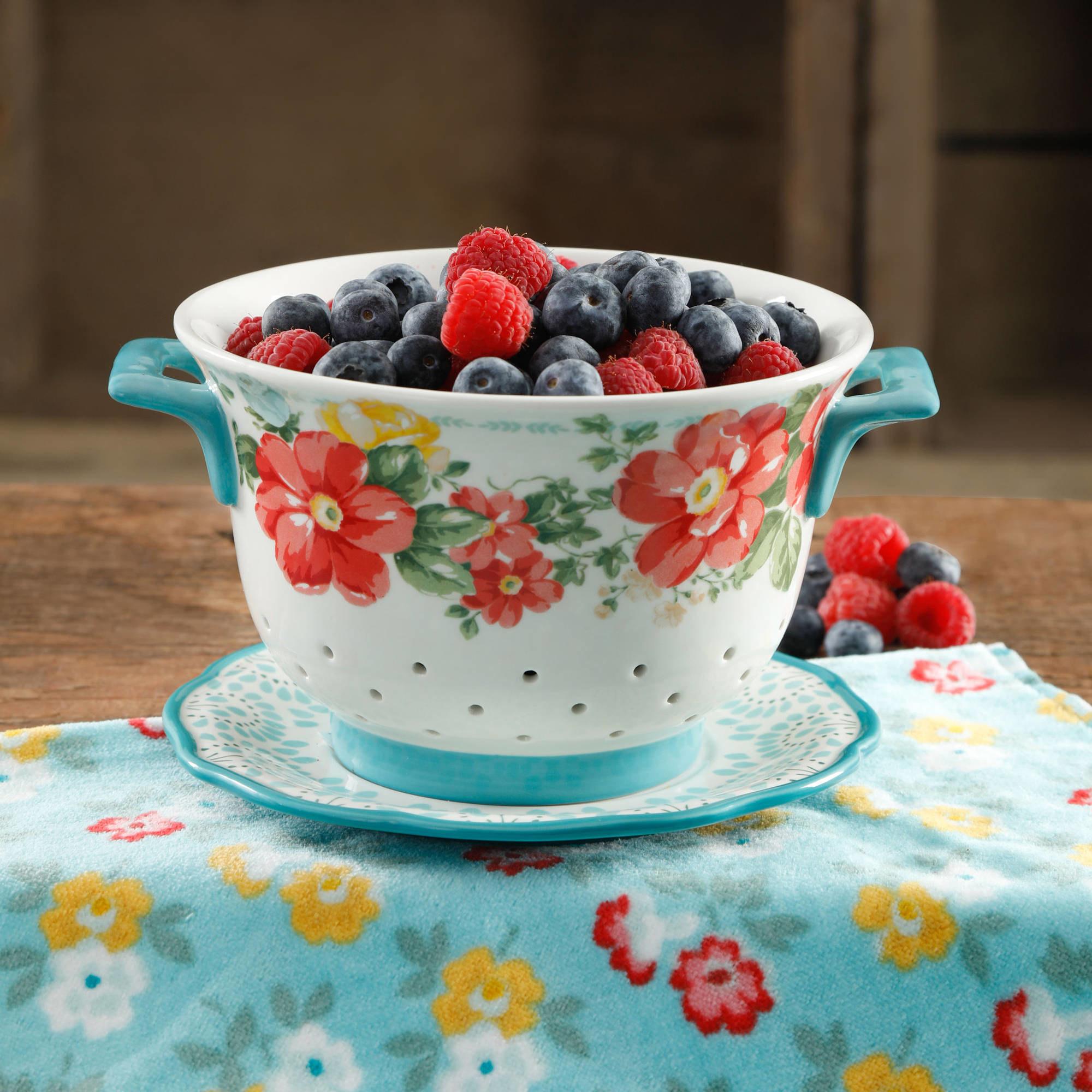 Floral serving colander with fruit inside