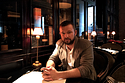 Vitali Shkliarov sitting in a cafe