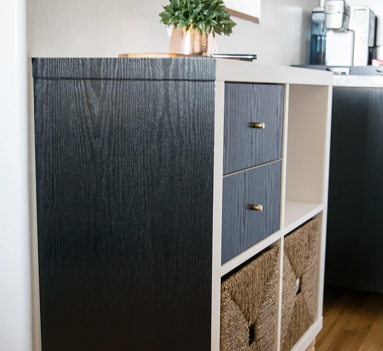 A dresser covered in dark wood film