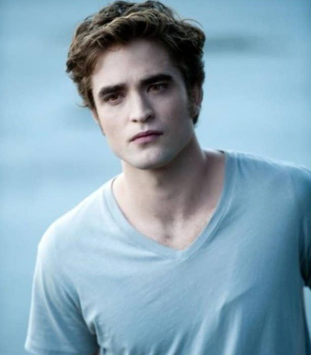 Robert Pattinson as Edward Cullen, wearing a v-neck t-shirt