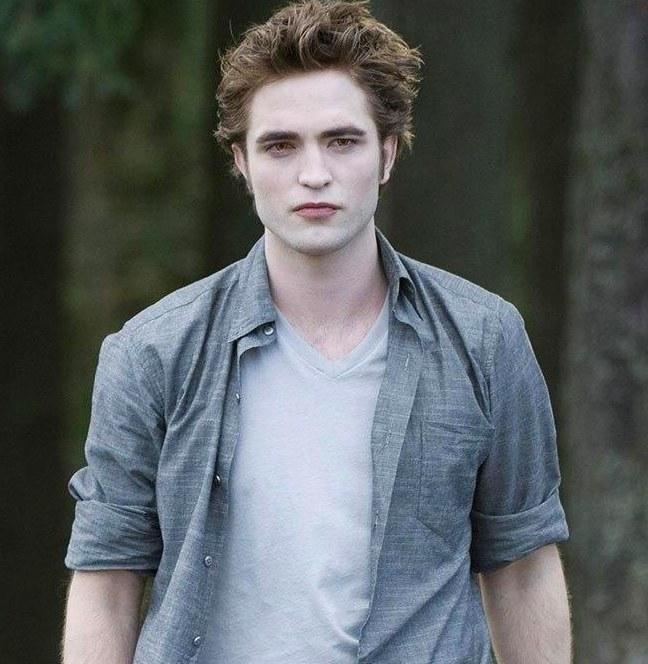Robert Pattinson as Edward Cullen, wearing a v-neck t-shirt and unbuttoned collared shirt