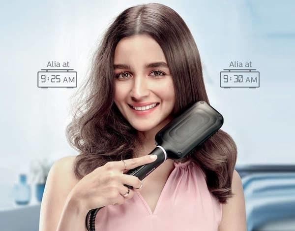 Bollywood actress, Alia Bhatt, using the straightening brush,