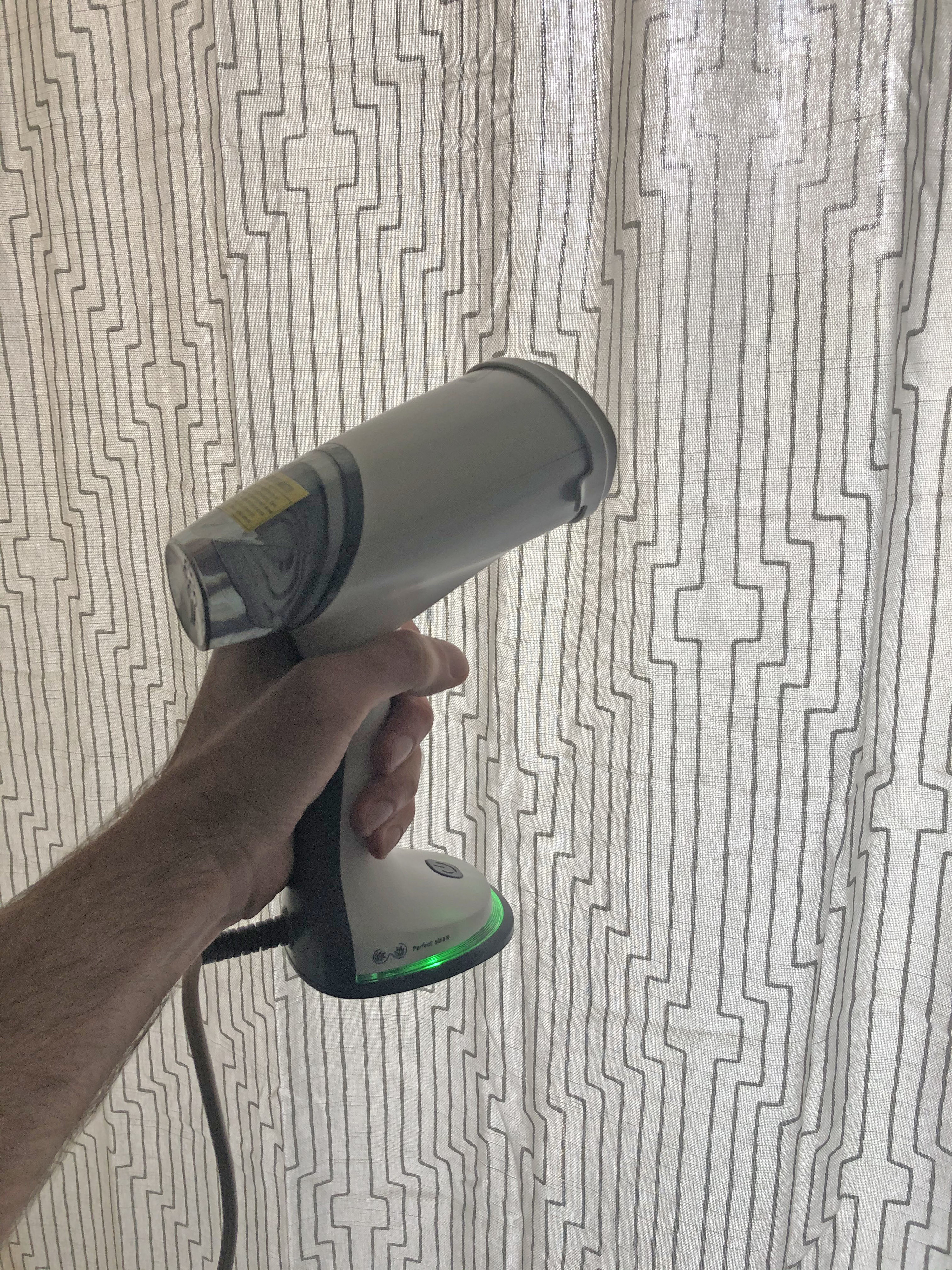 Picture of me steaming the curtains to get out the wrinkles.