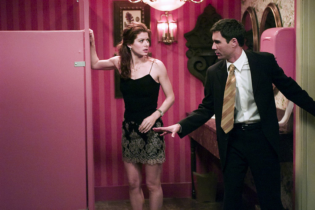 """Debra Messing as Grace and Eric McCormack as Will in a bathroom talking on """"Will & Grace"""""""