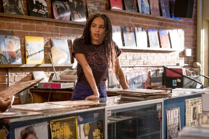 """Zoë Kravitz leaning over counter at record store in """"High Fidelity"""""""