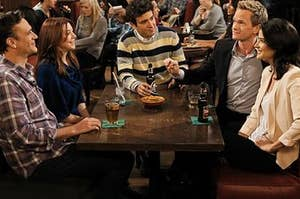 The HIMYM gang sitting in their favourite table at the Maclaren's Pub.
