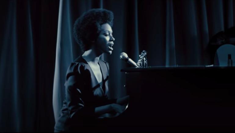 "Zoe Saldana as Nina Simone in ""Nina"" playing the piano and singing"