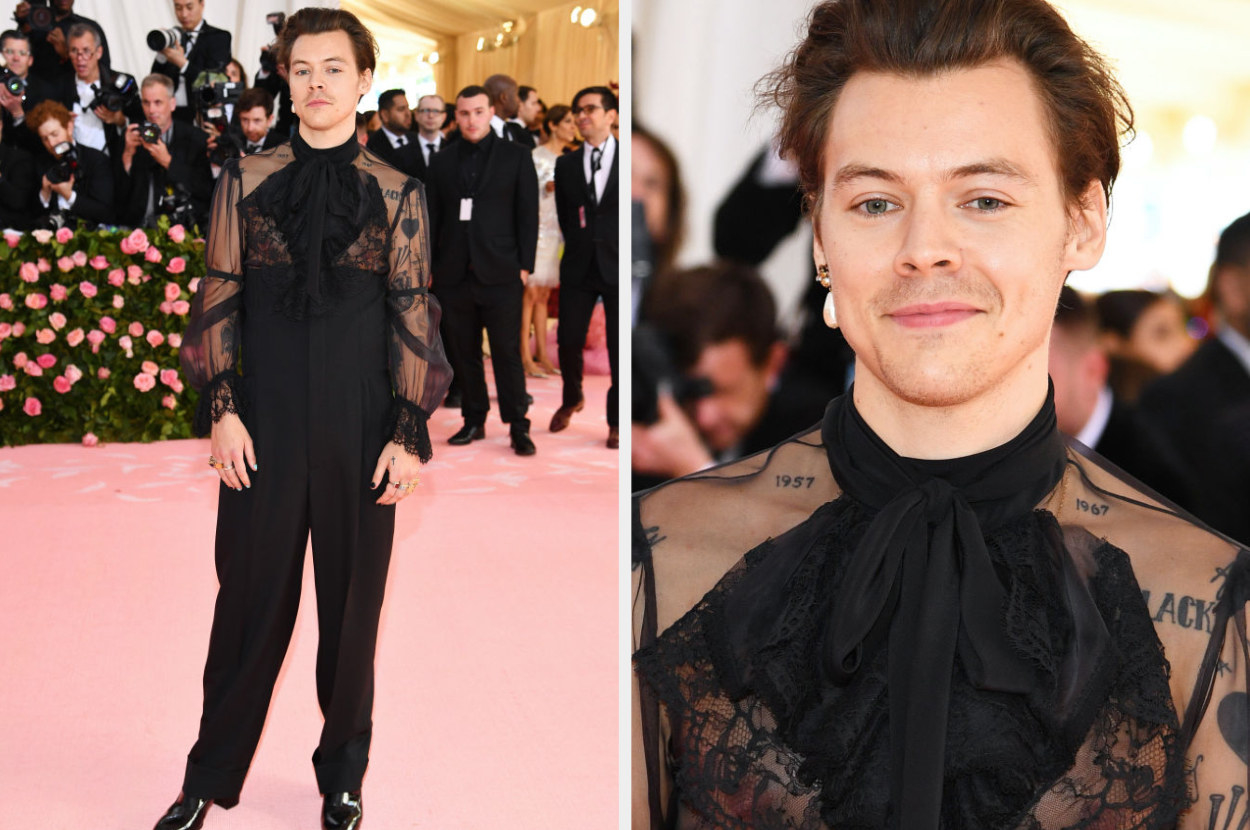 Harry posing for a picture wearing a lace romper with a bow