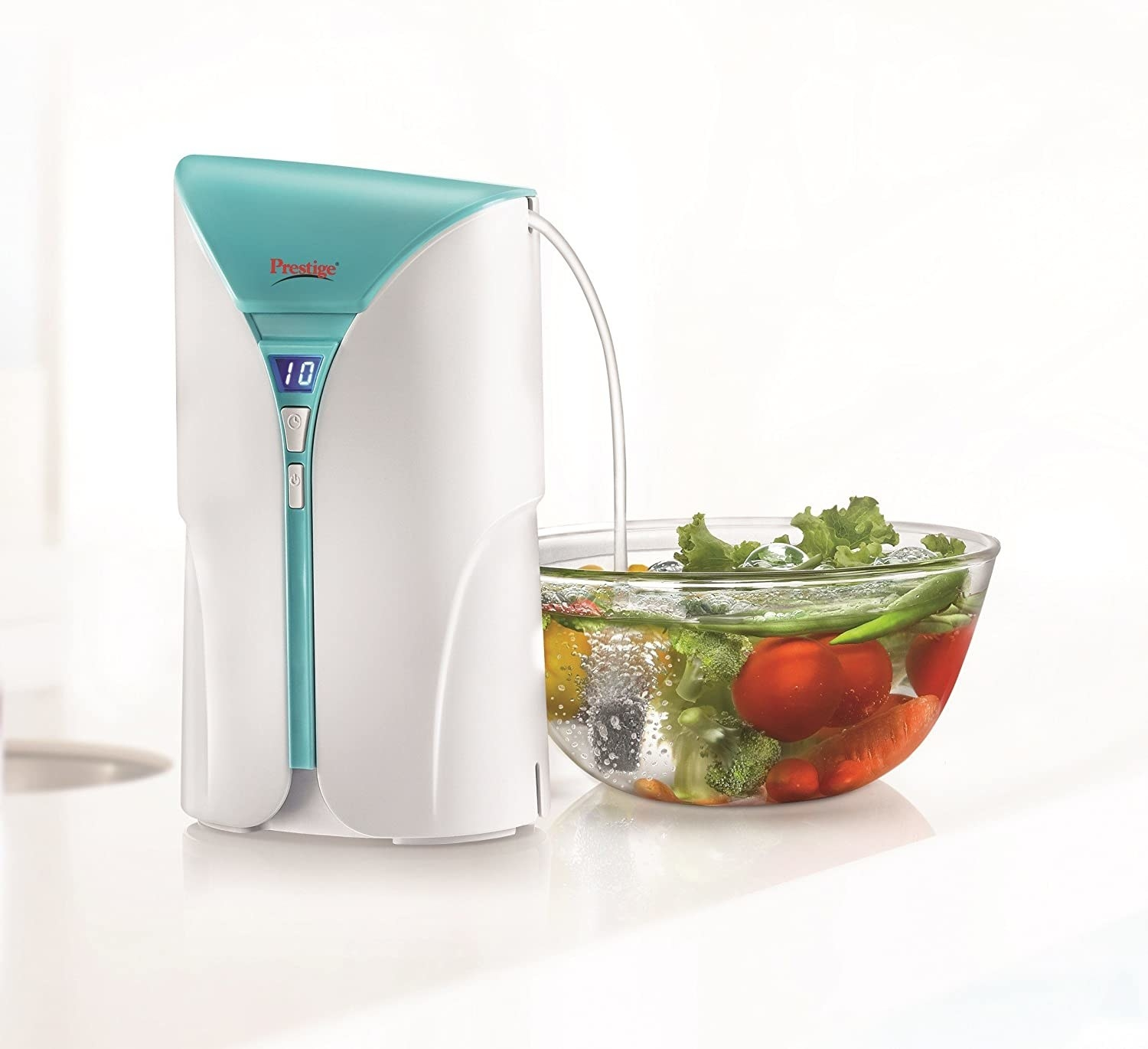 A food ozonizer pouring liquid into a bowl of vegetables