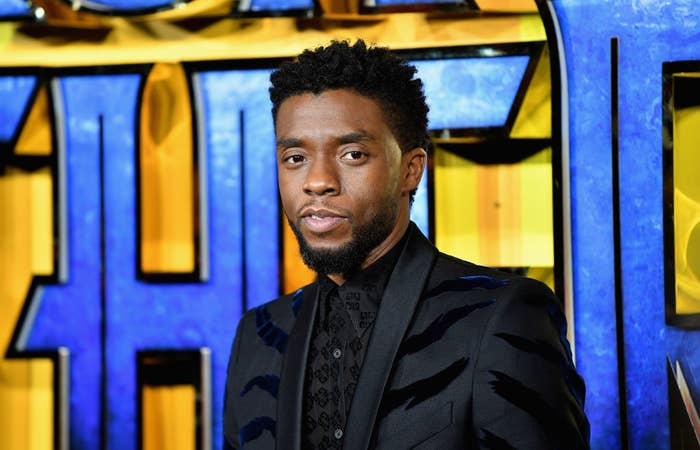 "Chadwick Boseman wearing a suit at the London premiere of ""Black Panther"""