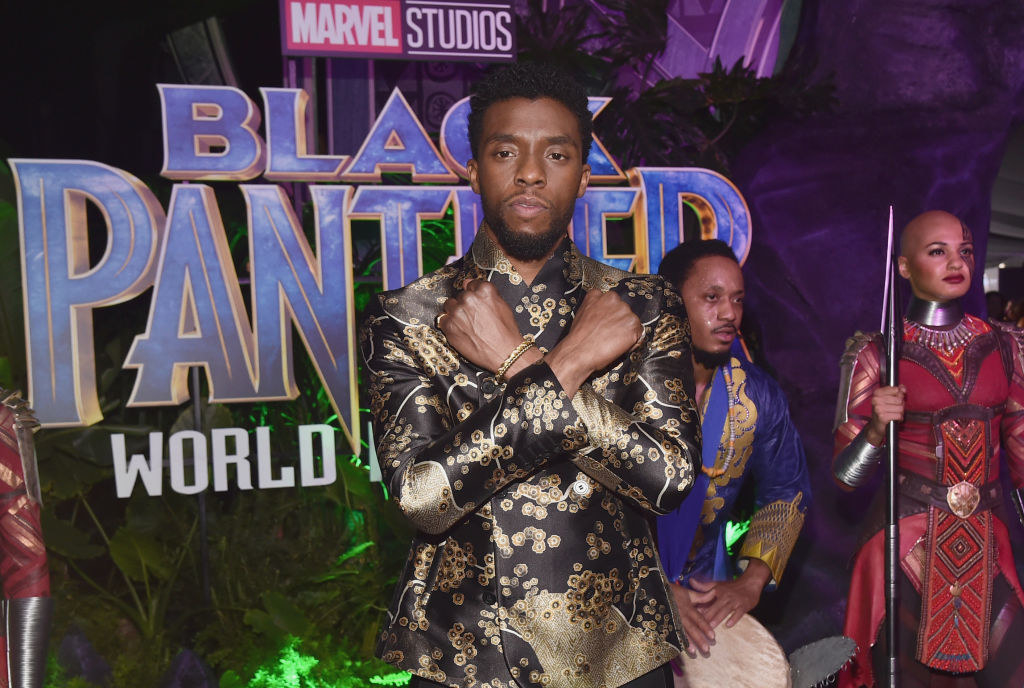 "Chadwick Boseman doing the ""Wakanda forever"" pose at a ""Black Panther"" premiere"