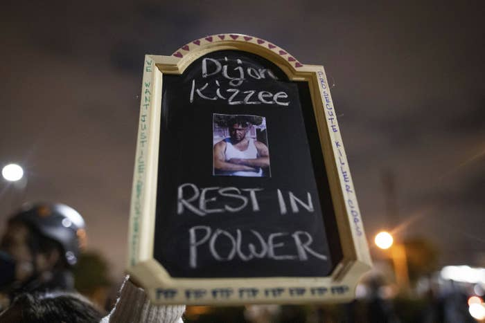 """The sign says """"Dijon Kizzee, rest in power"""""""