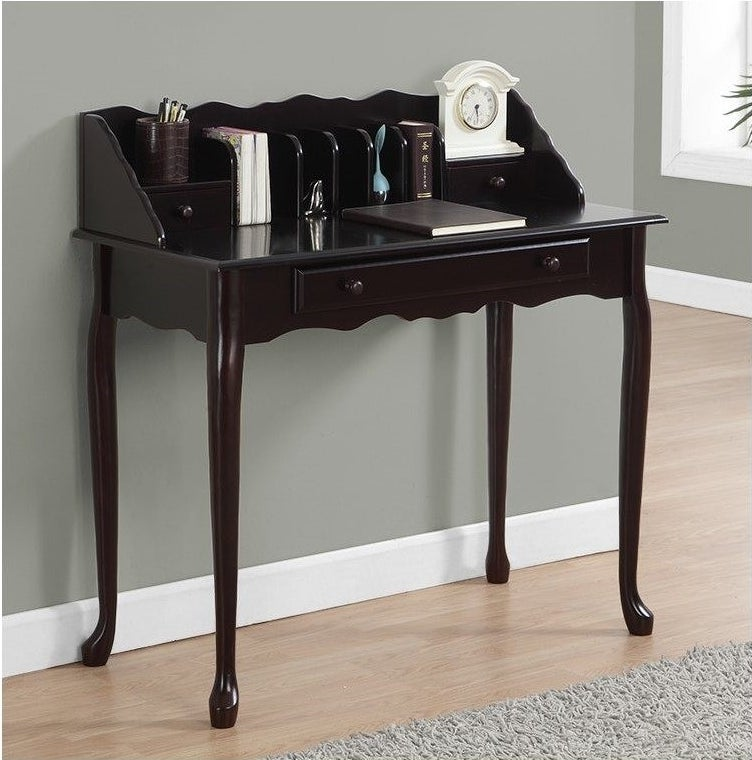 """The Monarch Desk 36""""L in Dark Cherry Traditional against a wall"""