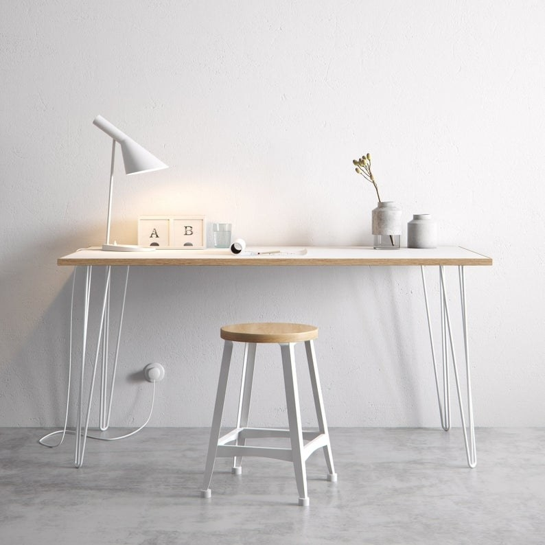 The Scandinavian look white formica coated birch table completed with hairpin legs against a white wall