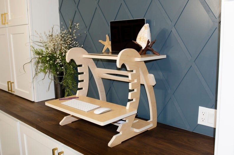 The Wave Standing Desk on a countertop