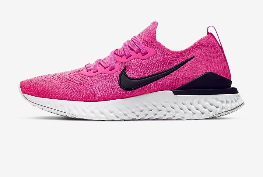 the pink Nike sneakers