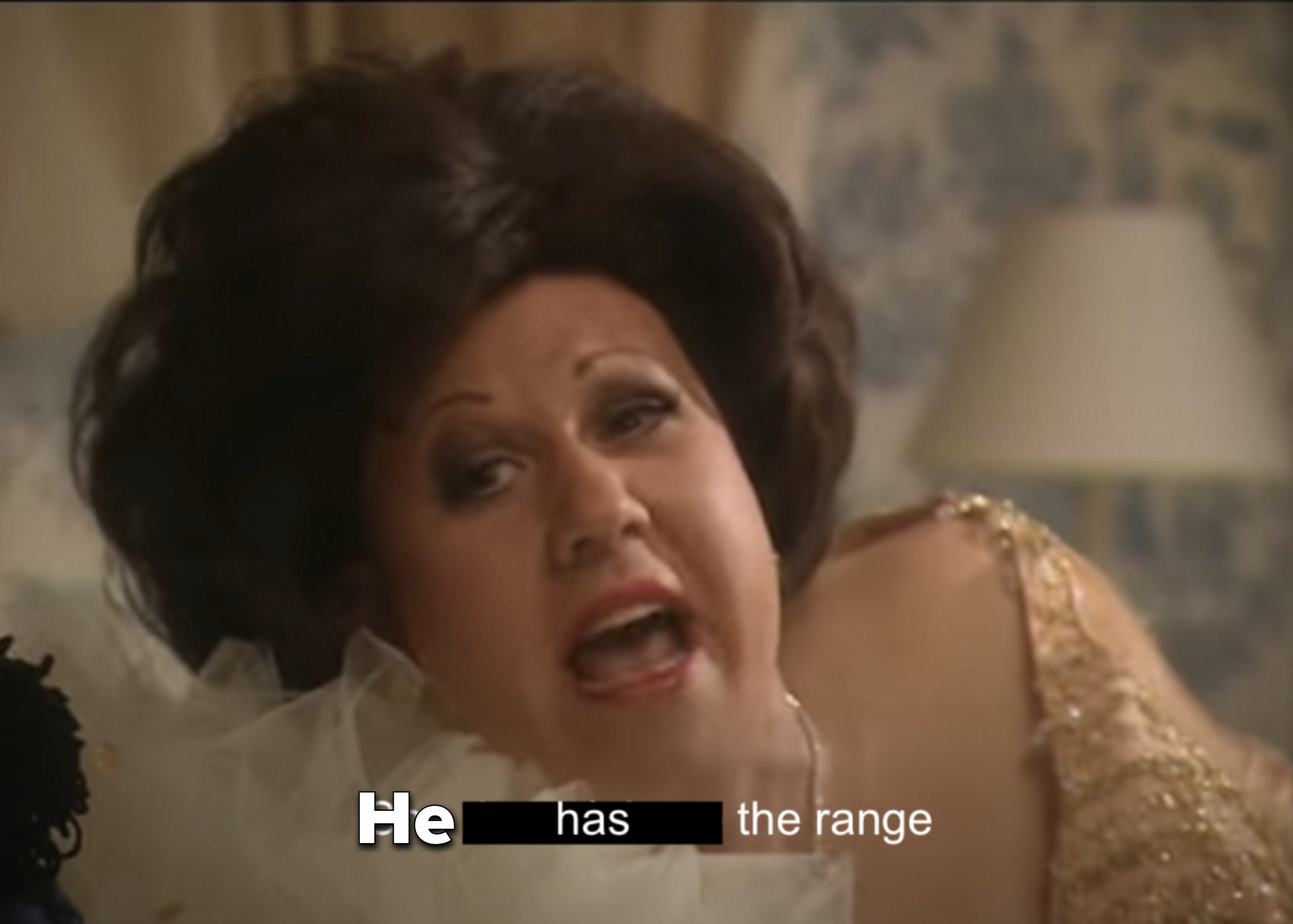 "Man dressed in drag saying ""He has the range"""