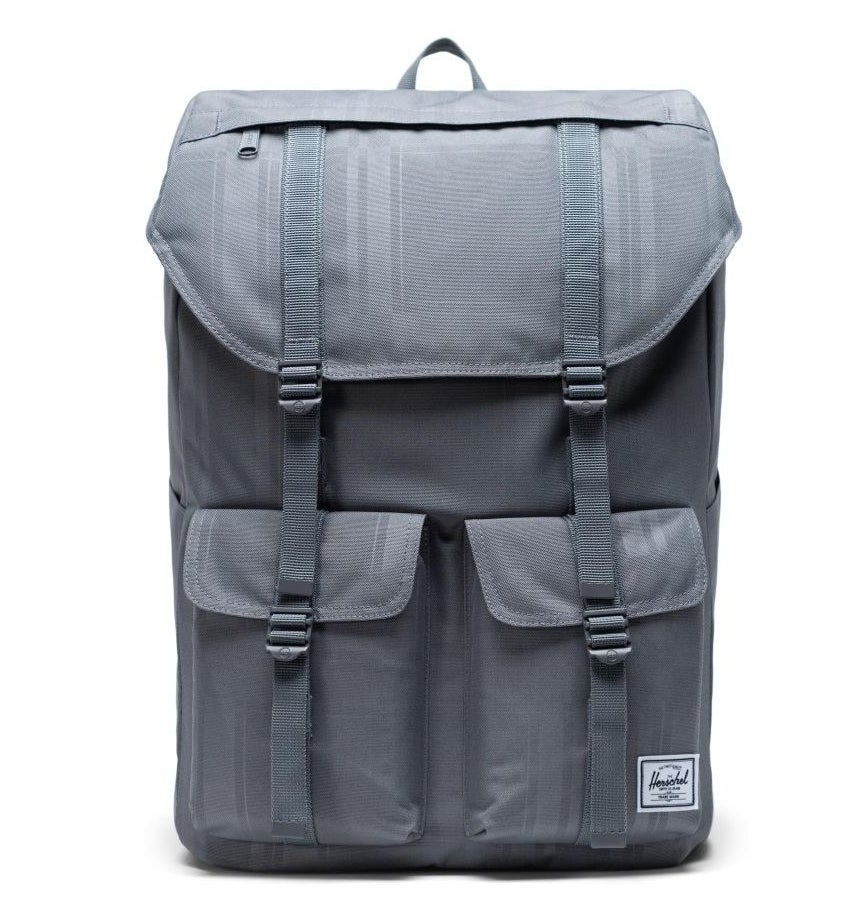 the light blue backpack with multiple pockets