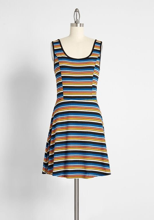 a dress with vertical blue, black, orange, yellow, and white stripes