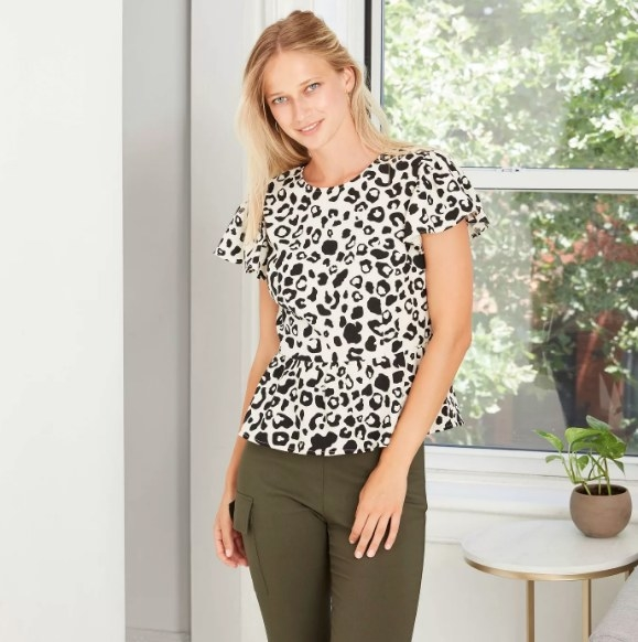 Model wearing the cow print top
