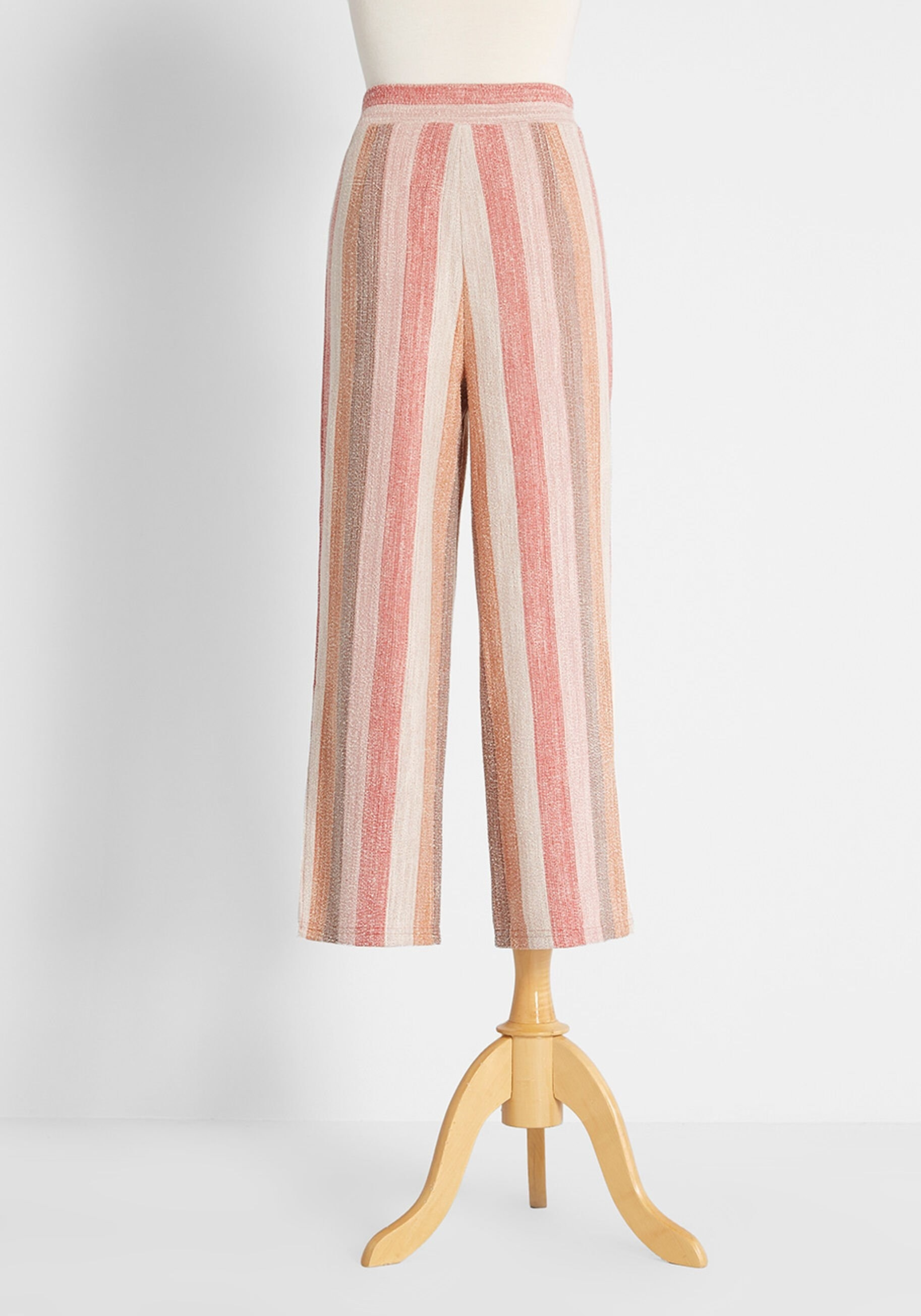 the pants in muted orange, white, pink, and tan coloring