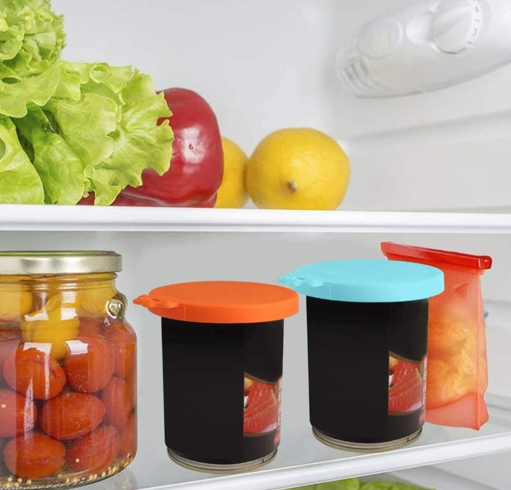 The silicone covers being used on jars in the refrigerator