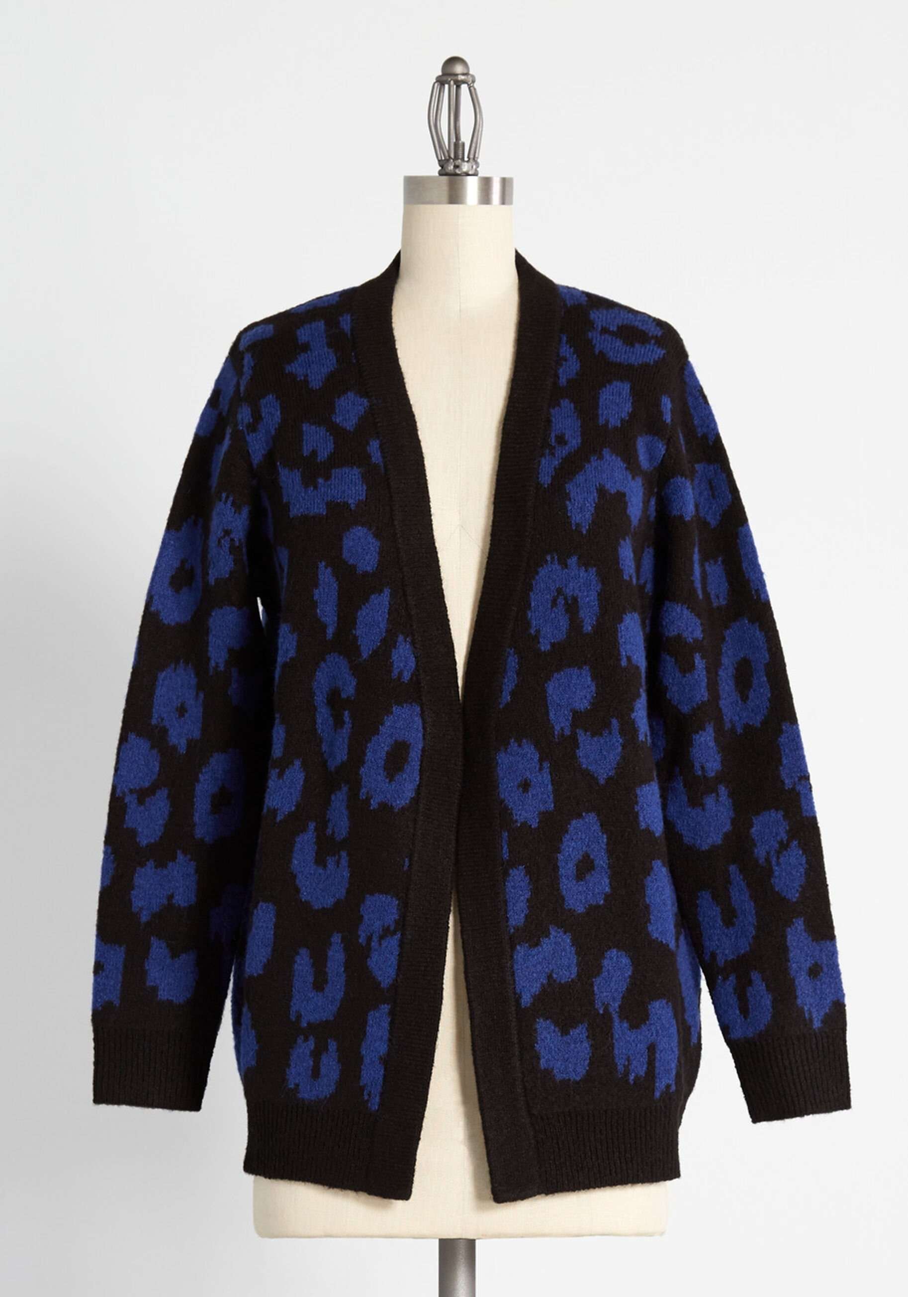 a thick black and blue leopard print cardigan