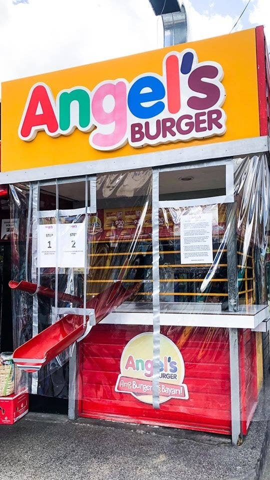 A burger stand with two small ramps leading to and from the counter