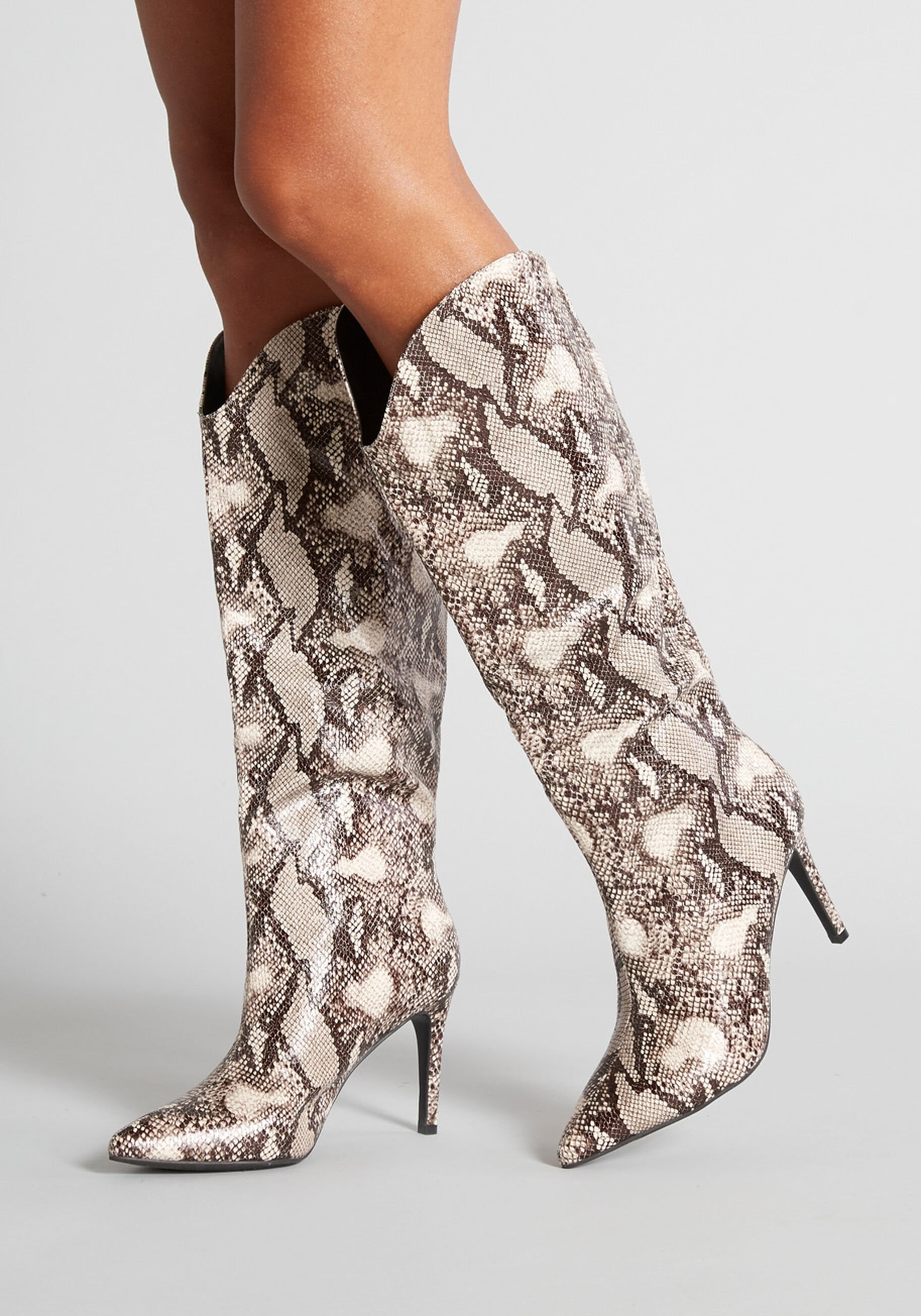 tall pointed snakeskin boots with a 3.25-inch stiletto heel